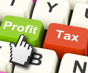 Profit Tax Computer Keys Showing Paying Company Taxes